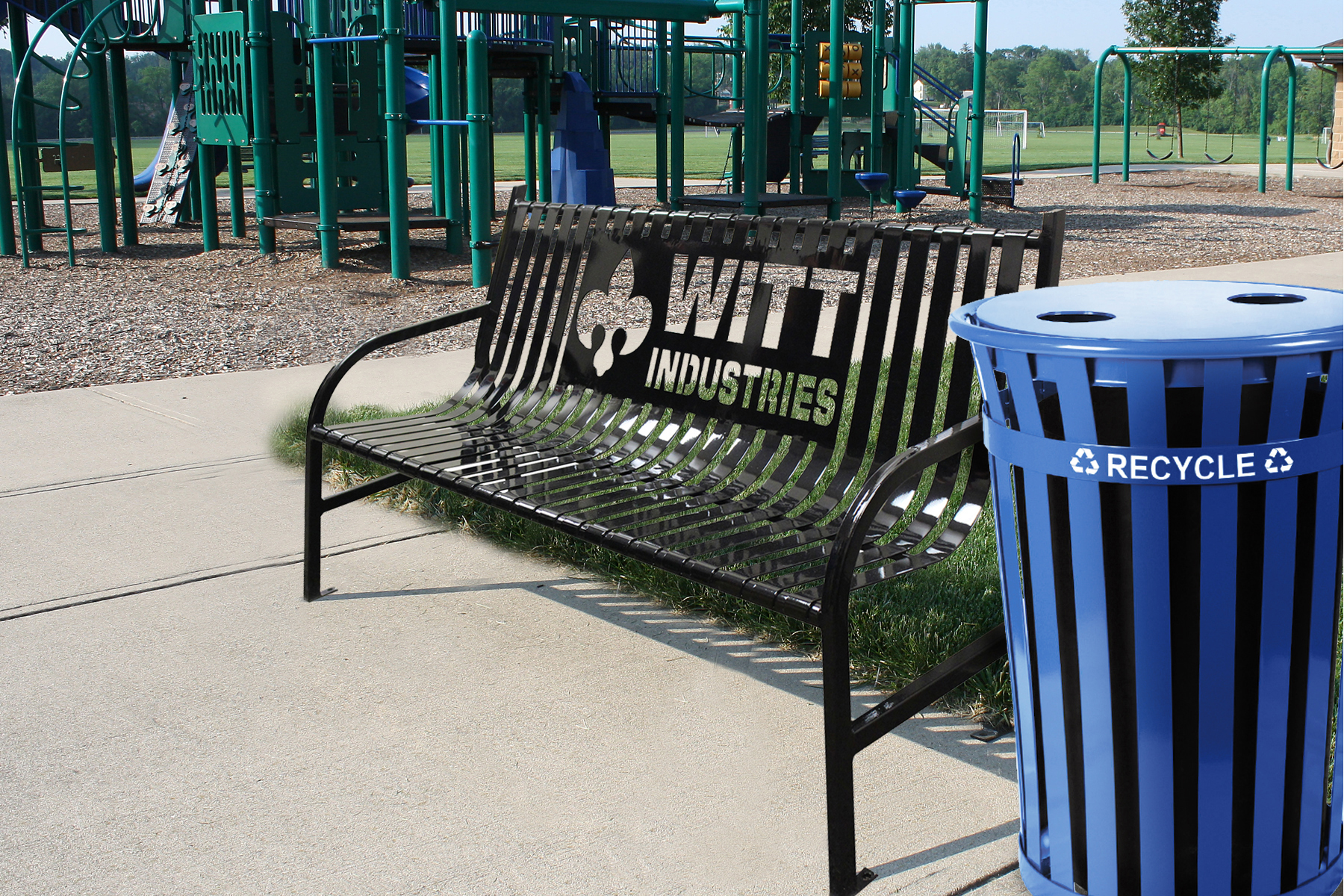 Witt Bench and Recycling Can in a Park